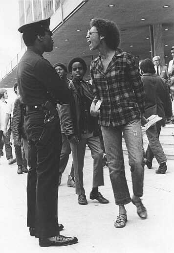 Shot on May 1, 1969 at the Federal Building in Downtown L.A. The marchers walked in a long oval with a line of LAPD officers 